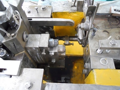 Hollow wall anchor screw forging machine structure