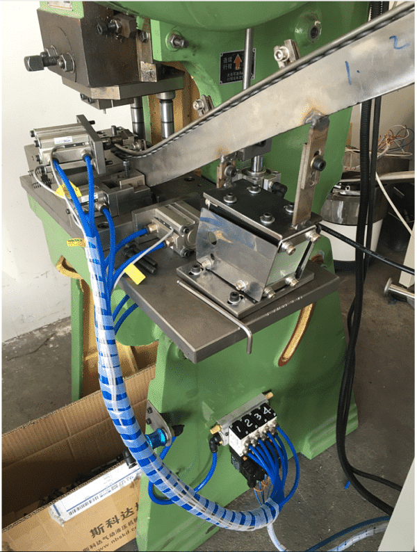 Ceiling anchors rivet head hole puncher machine