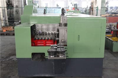 Round coupling nuts forming machine