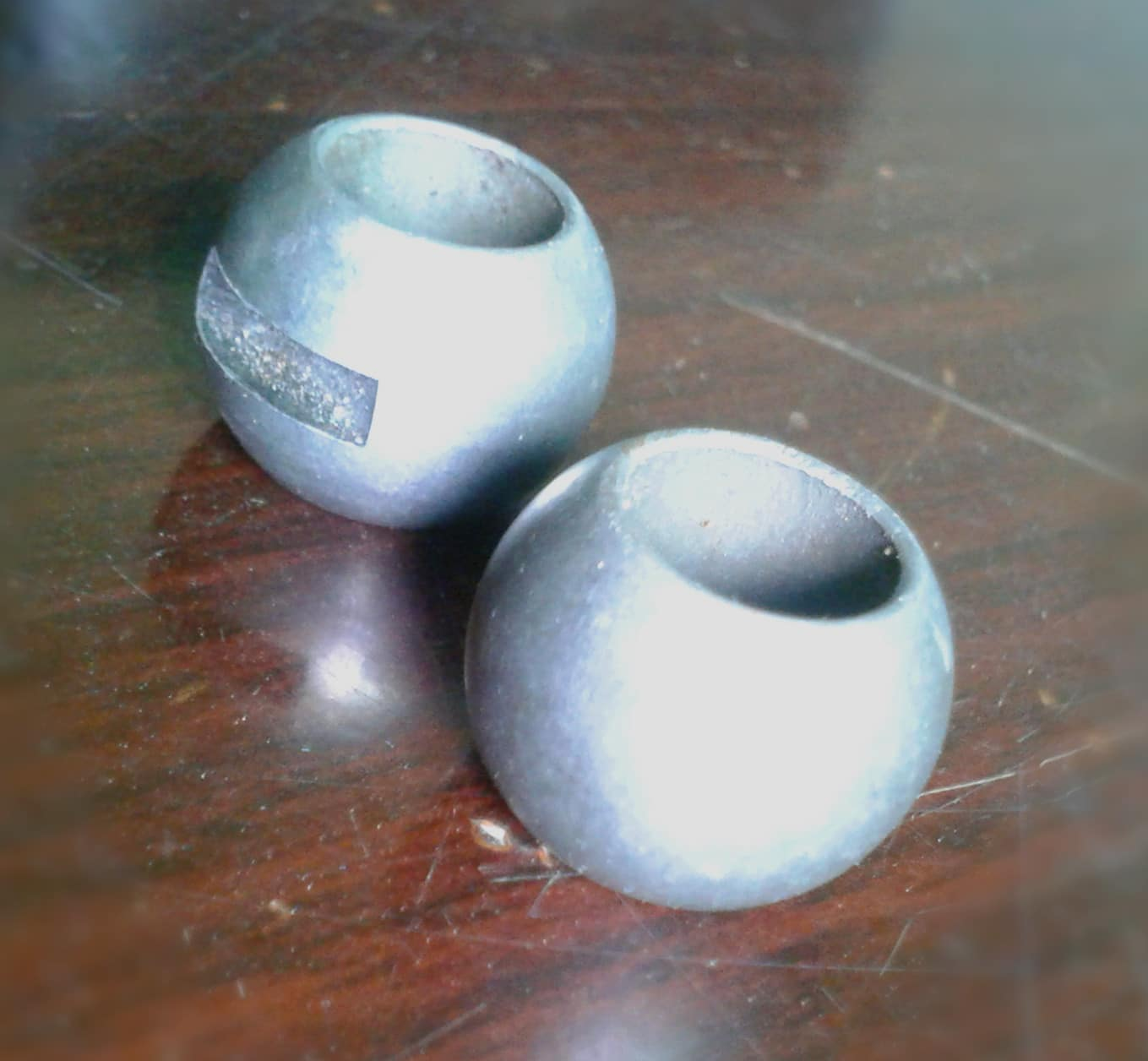 Slotted valve ball part